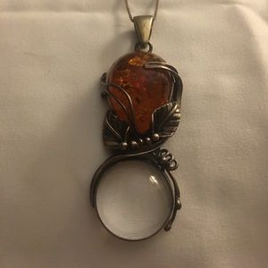 Jewelry - Sterling silver amber pendant w/magnifying glass.
